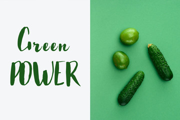 top view of limes and cucumbers with text Green Power on white and green surface