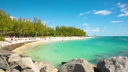 Fototapete - People having a rest on the Fort Zachary Taylor park beach. Raw video source.
