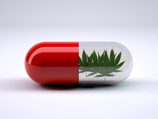 red pill with marijuana leafs inside