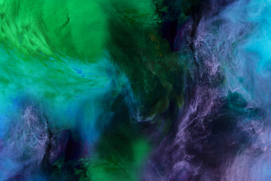 artistic texture with blue, purple and green paint swirls looks like space