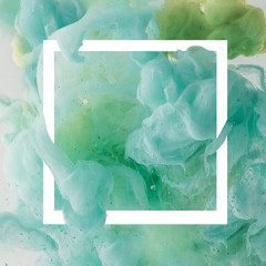 creative design with flowing turquoise paint in white square frame