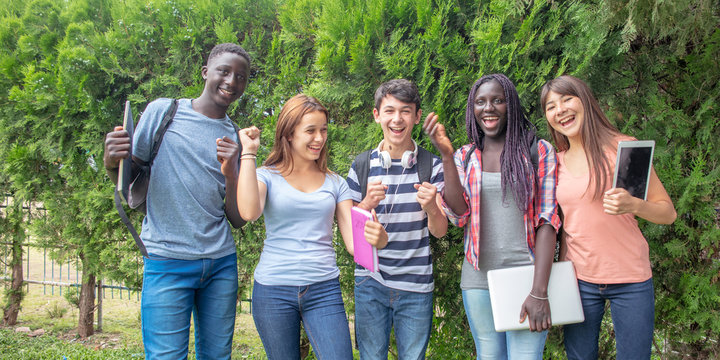 Group of mixed races teenagers happy smiling outdoor in the garden