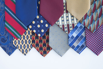 Photograph of men's neckties laid out in a pattern on white