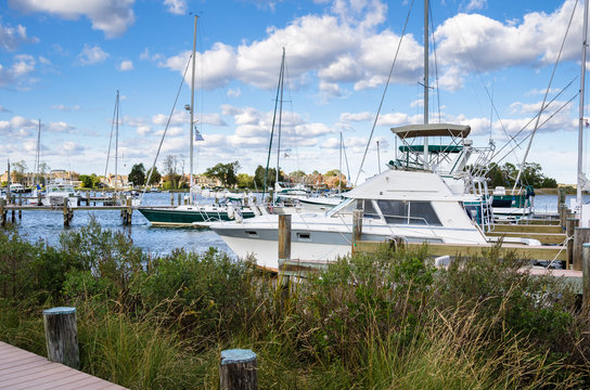 Yachts Moored to Wooden Piers in a Harbour under a Clear Autumnal Sky. St. Michaels, MD.