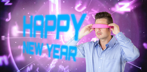 Man using pink virtual video glasses against blue and purple technology interface