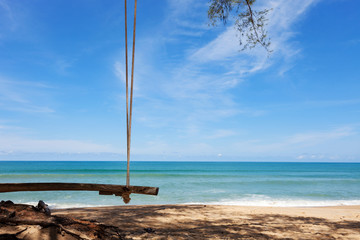 Wooden cradle on the tropical beach with scenery nature views background in summer season.