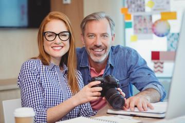 Portrait of graphic designers holding digital camera