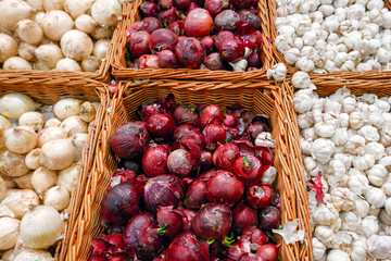 Purple and white onions in plenty on display at local farmer market.