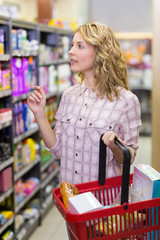 Pretty blonde woman buying a products