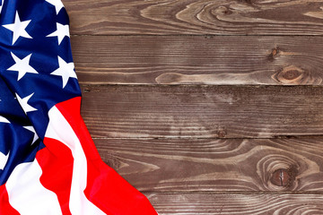 The Flag of the United States of America on wooden background .Independence day of the usa background