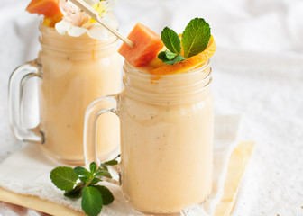 Fresh tropical smoothie with ingredients