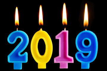 Burning candles in the form of 2019 for cake isolated on black background. The concept of celebrating the happy new year, cake decoration