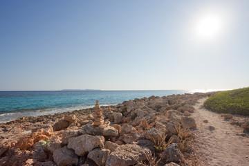 Cap de Ses Salines, Mallorca - A walk during sundown at the rocky beach of Ses Salines