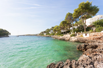Cala d'Or, Mallorca - A rocky coastline and turquoise water at the beach of Cala d'Or