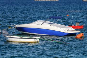 white motor boat at anchor