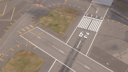 AERIAL: Pavement surface and flight markings on empty runway field on airport