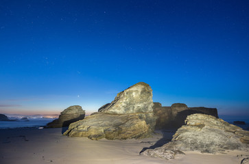 spring night on the beaches of galicia, spain, with the moon and venus