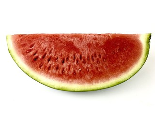 watermelon section on a white surface