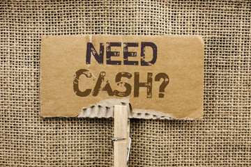 Writing note showing  Need Cash Question. Business photo showcasing Wealth Question Needy Currency Money Advice Conceptual written on Cardboard Piece Holding By Clip on the jute background.