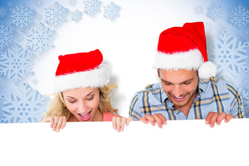 Young festive couple against blue and white snowflake design