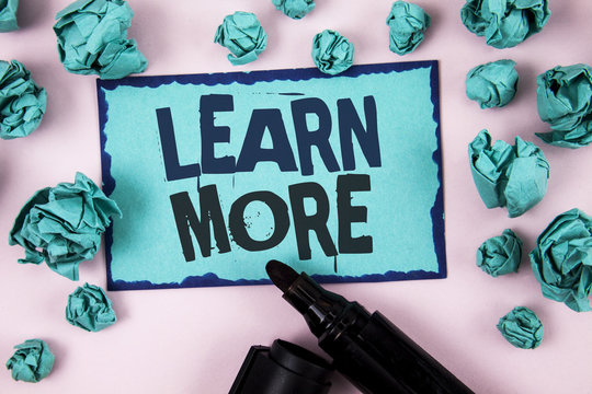 Word writing text Learn More. Business concept for Study harder Develop new skills abilities Get extra education written on Sticky Note paper on plain Pink background Paper Balls and Marker.
