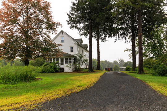 Long driveway to large rural American home