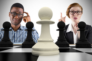 Composite image of business people playing chess against white background with vignette