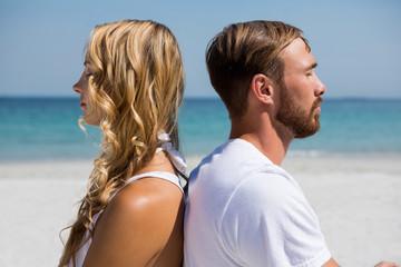 Close up of couple meditating at beach