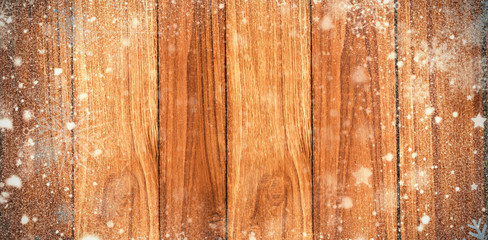 Snow against wooden background