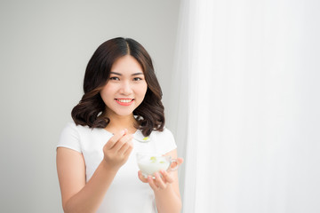 Woman On Healthy Diet. Closeup Of Beautiful Cheerful Girl With Glass Of Natural Yogurt