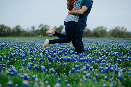 Couple in love in field of Texas Bluebonnets