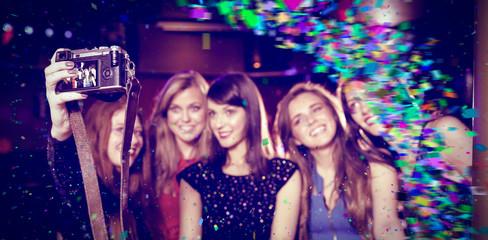 Colour curve against pretty friends taking a selfie