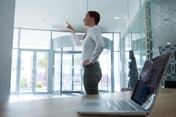 Female executive using invisible digital screen