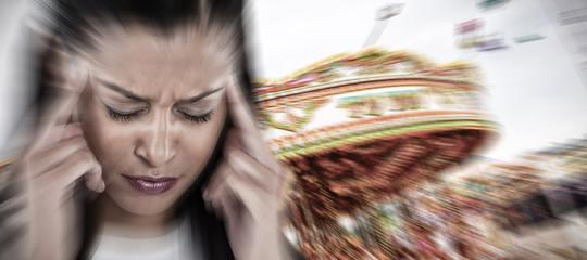 Businesswoman having an headache against carousel