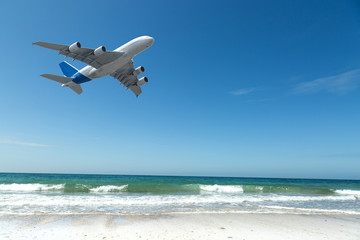 Flight of a passenger plane by the sea.