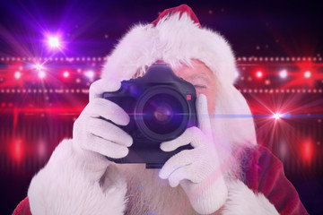 Santa is taking a picture against digitally generated nightlife light design