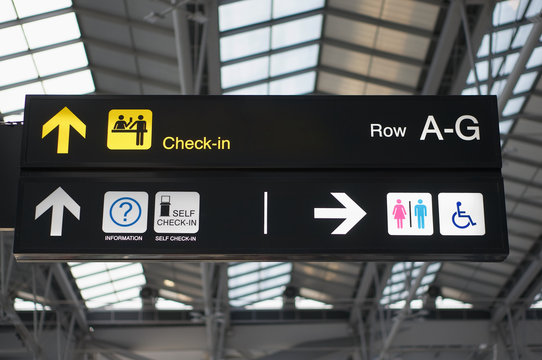 Self check-in and toilets board sign at international airport
