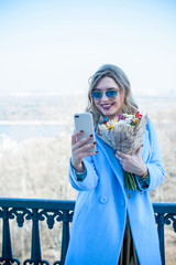 Women of plus size figure with mobile telephone, take a picture, selfie. Concept of technology in modern life