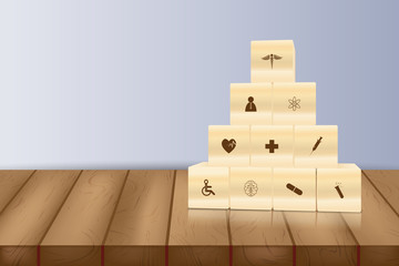 Hand arranging wood block stacking with icon healthcare medical,