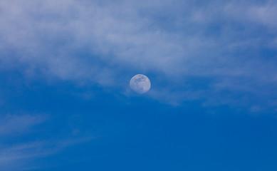 the moon against the blue sky