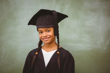 Little girl wearing graduation robe