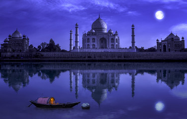 Fototapete - Taj Mahal Agra in full moon night with wooden boat on river Yamuna. Photograph shot from Mehtab Bagh.