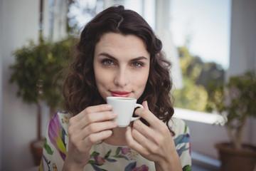 Portrait of beautiful woman having coffee