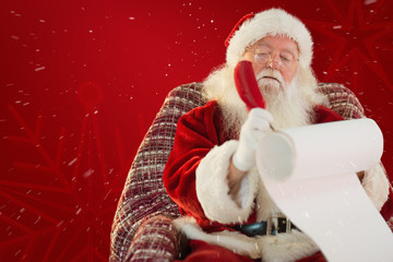 Father christmas writing list with a quill against red snowflake background
