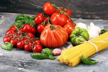 Italian food background with pasta, basil and tomato, health or vegetarian concept.