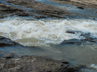 Shallow stone rapids of a mountain river
