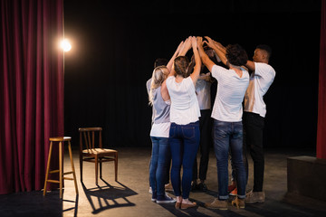 Actors team forming their hands stacked