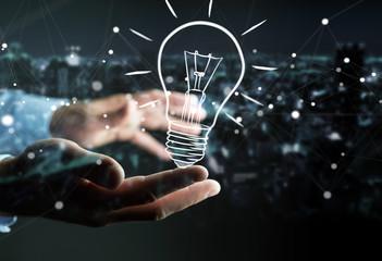 Businessman holding a sketch lightbulb