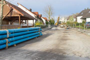 Auswechseln einer Wasserleitung im Wohngebiet