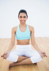 Beautiful slender woman meditating in lotus position